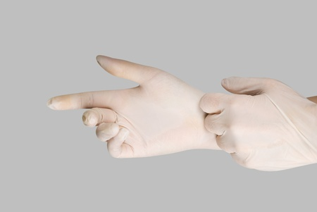 gloving up: gloves on a hand on a grey background