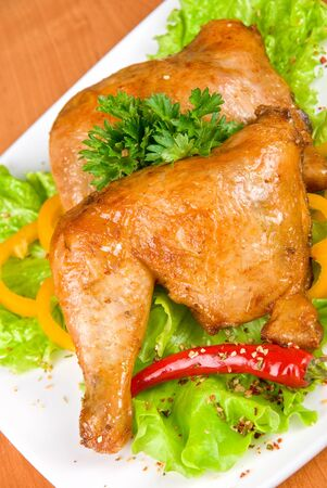 roasted chicken ham garnished with fresh green salad, pepper and greens photo