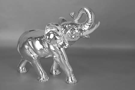 Silver jewelry elephant on a grey photo