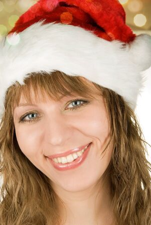 Happy pretty santa woman on firtree background photo