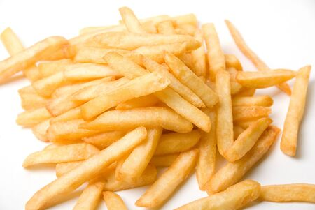 French fried potatoes on a white background photo