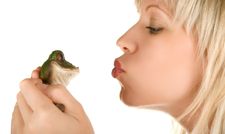 Frog prince being kissed by a beautiful blond girl photo