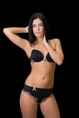 Giovane donna sexy bella in reggiseno nero su nero Archivio Fotografico