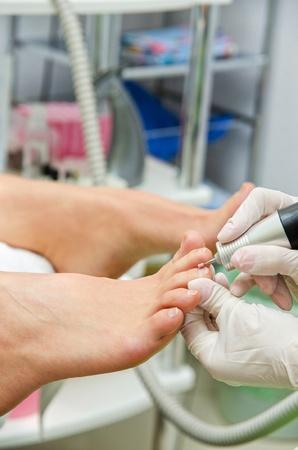 professional machinery pedicure in beauty salon photo