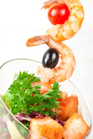 Fried kebab of shrimps with vegetables, greens and salmon fish Stock Photo - 8813703