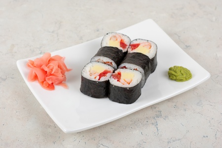 Sushi rolls made of crab meat, cheese, and tomato photo