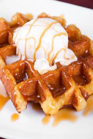 Tasty waffle and ice cream with cream