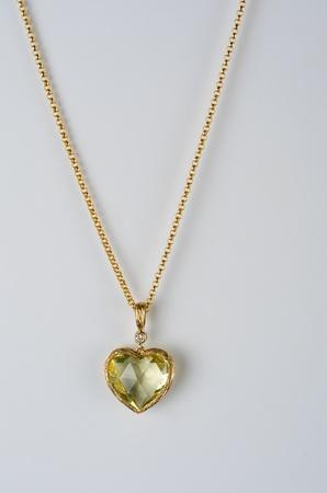 pendant: heart pendant of gold, diamond and lemon quartz