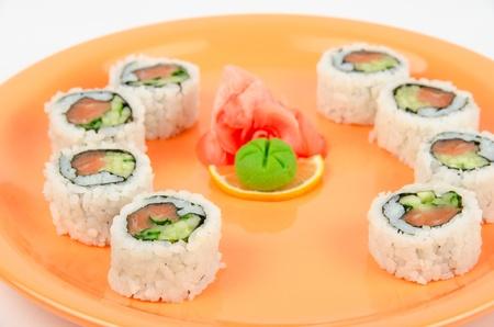 sushi at orange plate isolated on a white background photo