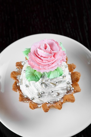 fresh baked cupcake on a wooden table photo