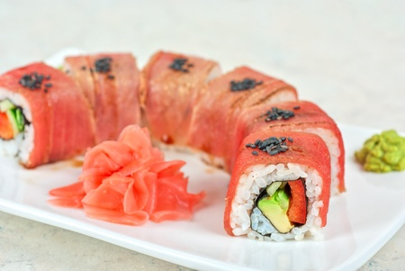 sushi plate: Fuji Sushi rolls made of tuna, pepper, avocado, cucumber