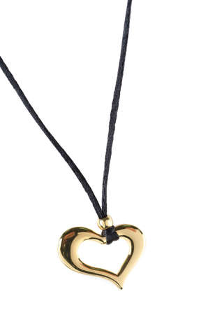 heart pendant of gold isolated on a white photo