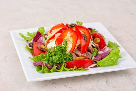 spicy salad of roast beef with potato, tomato, cabbage, pepper and lettuce photo