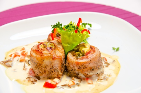 fillet trout fish with baked vegetables and mushroom sauce photo