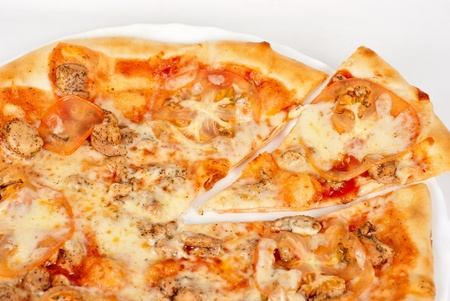 pizza closeup with chicken fillet, tomato and mozzarella cheese photo