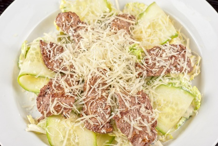 Salad with beef, lettuce, cucumber, string beans, Chinese cabbage and sauce photo