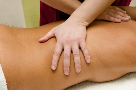 closeup of young woman getting a back massage photo