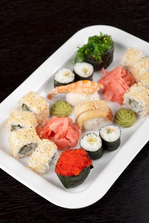 japanese sushi set with red tobiko sushi in the foreground photo