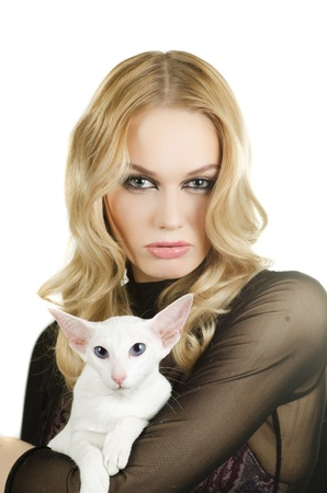 beauty young blond woman with oriental shorthair cat on a white photo