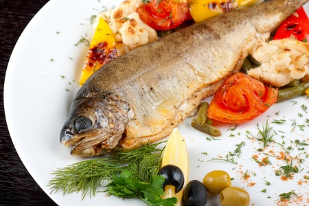 trout fish baked with pepper, string beans, tomato and cauliflower photo