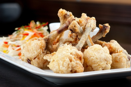 Fried chicken wings garnished with fresh vegetables with Teriyaki sauce Stock Photo - 9539470