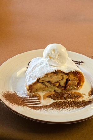 apple strudel tasty dessert dish at plate closeup photo