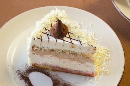 tasty cake at white plate closeup photo photo