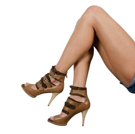 beautiful femail legs in shoes isolated on white photo