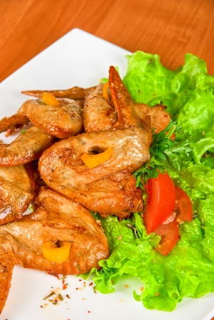roasted chicken wings garnished with fresh green salad, pepper and greens Stock Photo - 9785582