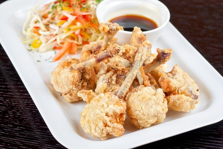 Fried chicken wings garnished with fresh vegetables with Teriyaki sauce Stock Photo - 9785630