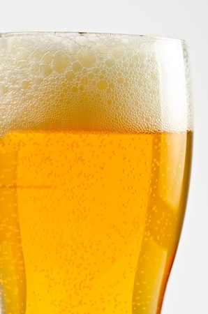 Glass of beer closeup on a white background Stock Photo - 9785673