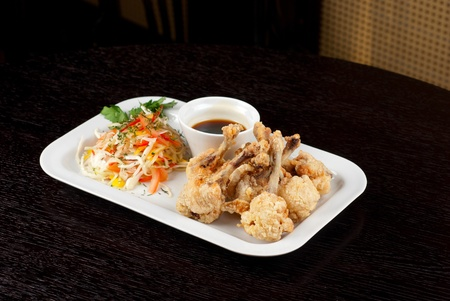 Fried chicken wings garnished with fresh vegetables with Teriyaki sauce Stock Photo - 9785748