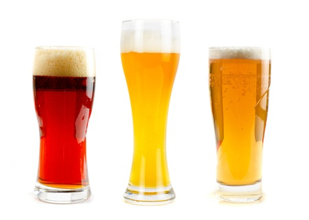 Set of different kind of beer at glasses isolated on a white background photo