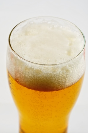Glass of beer closeup on a white background photo