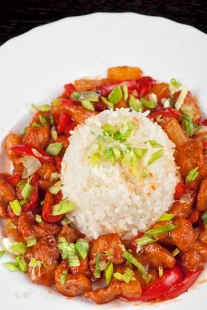 Pork meat and vegetables and pineapple with japanese rice photo