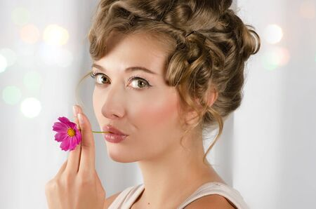 Beauty woman closeup portrait with flower over grey background Stock Photo - 10129631
