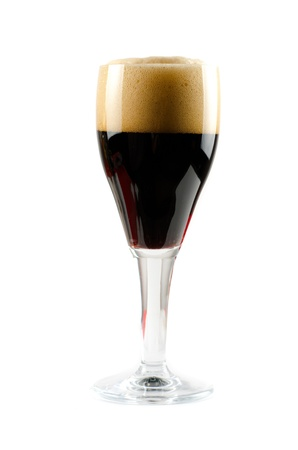 Glass of dark beer isolated on a white background photo