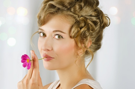 beauty woman closeup portrait with flower over grey background Stock Photo - 10243923