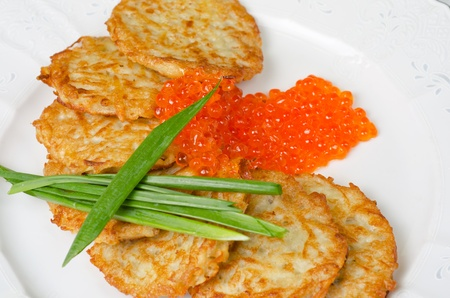 pancakes with red caviar and green onion closeup dish photo