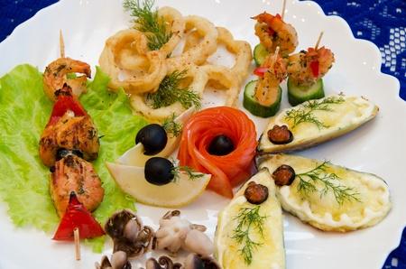 variety eatable seafood set on the dish photo