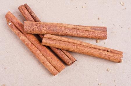 Cinnamon stick closeup on a brown background photo