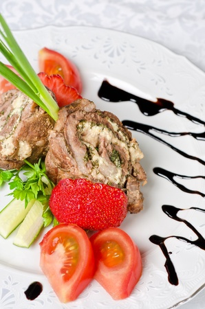Pork rolls with cheese and vegetables: onion, cucumbers, tomatoes Stock Photo - 10597712