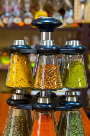 Different spices on the counter of market photo