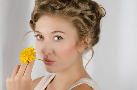 beauty woman closeup portrait with flower over grey background Stock Photo - 10671614