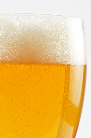 Glass of beer closeup on a white background Stock Photo - 10703159