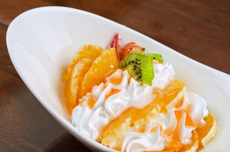 Ice cream dessert with kiwi, strawberry and orange Stock Photo - 10723096