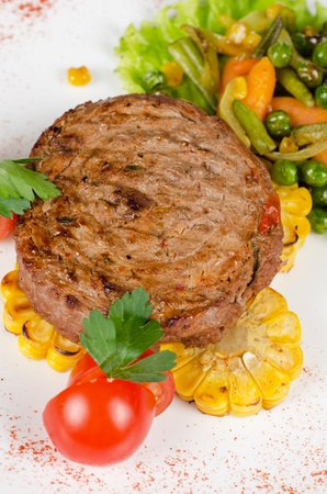 BBQ meat steak with vegetables and greens photo
