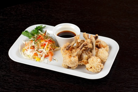 Fried chicken wings garnished with fresh vegetables with Teriyaki sauce Stock Photo - 10777030