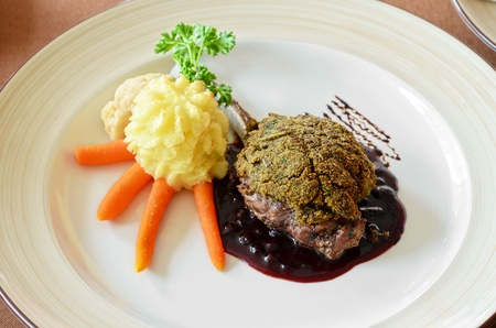 venison with whortleberry sause, herb and vegetales photo