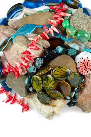 Close up of many different colorful natural gems: agate onyx, coral photo